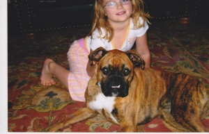 Our less-than-photogenic dog, Tango, with my daughter, Isabella, her