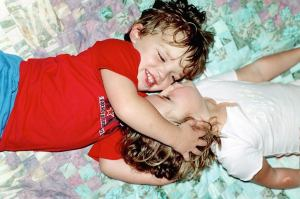 My children as babies, innocent and playful and loving each other.