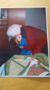 Grandma Rhetta gets a BIG hug from 5-year-old Mario for the beautiful quilt she made him.